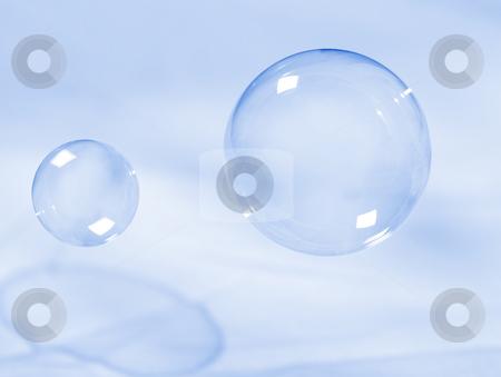 Soap bubbles stock photo, Soap bubbles on light blue background by msk_nina