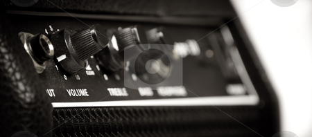 Dusty retro Guitar amp stock photo, Knobs of different functions on a guitar amp by elemery