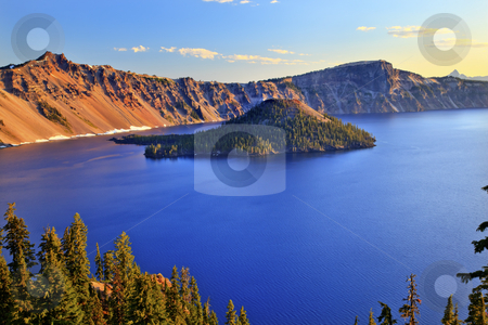 Crater Lake Reflection Blue Lake Morning Oregon stock photo, Crater Lake National Park Wizard Island Blue Lake Morning Oregon Pacific Northwest by William Perry