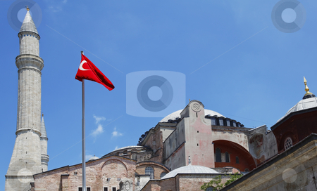 Dome spire Turkish flag Hagia Sofia stock photo, Turkish flag waving on a mast in the summer breeze, blue sky, spire, exterior landscape, crop space and copy space by Kantilal Patel