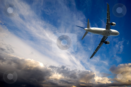 Plane and bad weather stock photo, Plane is escaping from bad weather by Lars Christensen