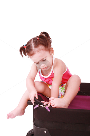 Little girl in a suitcase. Isolated on a white background  stock photo, Little girl in a suitcase. Isolated on a white background  by dacasdo