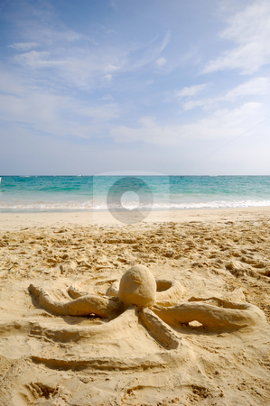 Octopus sculpture on beach stock photo, A octopus sand sculpture on a beach by Lars Christensen