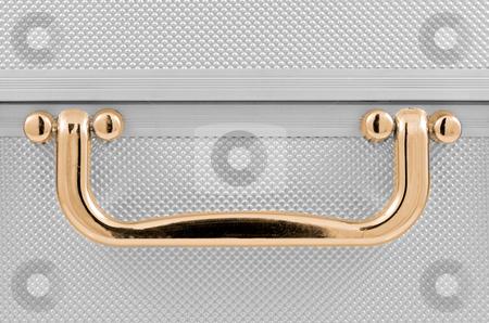 Golden handle stock photo, Golden handle detail of an aluminum case. by Homydesign