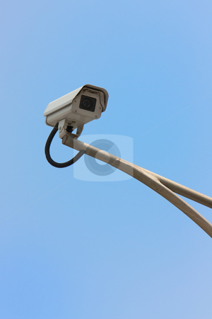Security camera stock photo, Security camera with clear blue sky by meccasky