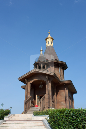 Small wooden church stock photo, small wooden church with golden roof by meccasky