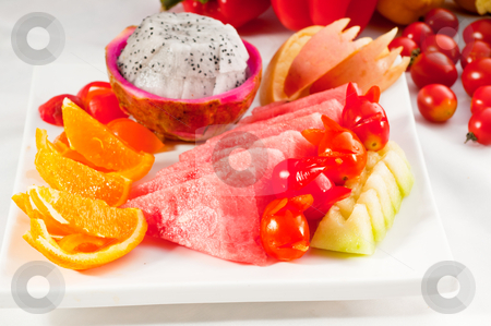 Mixed plate of fresh sliced fruits stock photo, mixed plate of fresh fruits,pitaya or dragon fruit with watermelon, orange,apple and cherry tomatoes,MORE DELICIOUS FOOD ON PORTFOLIO by Francesco Perre