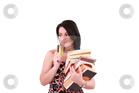 Young woman paying high bills with credit card stock photo, young woman paying high bills with credit card by dacasdo